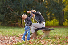 Little boy and mother playing together Stock Photos