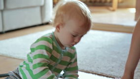 Little boy with mother playing with toy train. HD stock video footage