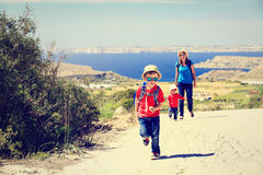 Little boy with mother and sister travel walk on Royalty Free Stock Image