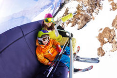 Little boy with mother on ski chair lift Stock Photography