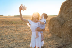 Little boy and mother to fly like a plane. Stock Photos