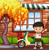 Little boy and motocycle on street Stock Image