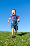 Little boy in move. Little boy in fast move, park blue sky Stock Photography