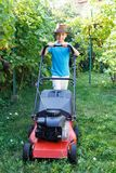 Little boy mowing lawn in backyard Royalty Free Stock Images