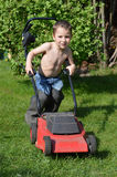 Little boy mowing lawn Royalty Free Stock Images