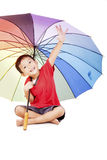 Little boy with multicolored umbrella Stock Images