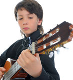 Little boy musician playing guitar Royalty Free Stock Photography