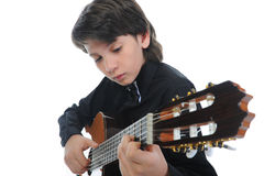 Little boy musician playing guitar Stock Images