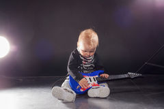 Little boy musician playing rock music on the guitar Royalty Free Stock Images