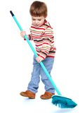 Little boy my mother's helper, sweeping brush the Stock Photography