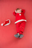 Little boy napping in santa costume Royalty Free Stock Image