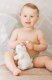 Little boy in a nappy with blue eyes Stock Images