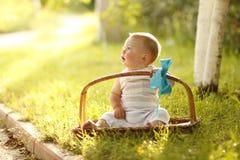 Little boy near the basket to nature. A little boy near the basket to nature Stock Photos
