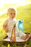 Little boy near the basket to nature Royalty Free Stock Images