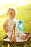 Little boy near the basket to nature. A little boy near the basket to nature Royalty Free Stock Images