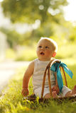 Little boy near the basket to nature. A little boy near the basket to nature Stock Photo