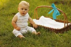Little boy near the basket to nature. A little boy near the basket to nature Stock Photography