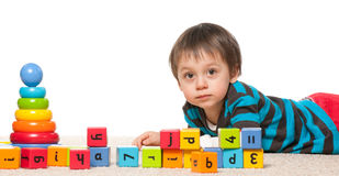 Little boy near blocks with alphabet Stock Photos