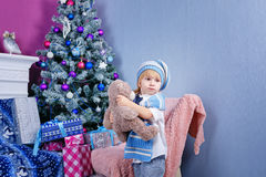 Little boy near Christmas tree Stock Photos
