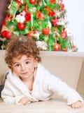 Little boy near Christmas tree Stock Images