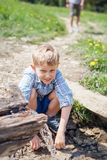 Little boy near clear mountain stream Royalty Free Stock Photo