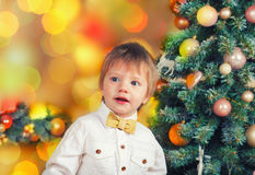 Little boy near decorated Christmas tree Royalty Free Stock Image