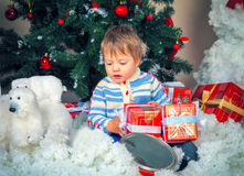 Little boy near decorated Christmas tree Royalty Free Stock Images