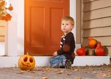 Little Boy Near Halloween Pumpkin Royalty Free Stock Photography