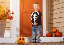 Little Boy Near Halloween Pumpkin Stock Images