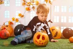Little Boy Near Halloween Pumpkin Stock Photography
