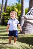 The little boy near the hammock Stock Image