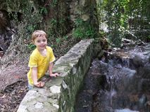 Little boy near a mountain river spring Royalty Free Stock Photography