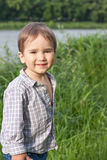 Little boy near the river Stock Photography