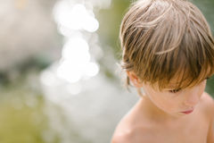 Little boy near water at the beach on hot summer day Stock Photography
