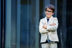 Little boy in a nice suit and glasses. Back to Royalty Free Stock Photography