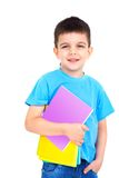 Little boy with notebooks Royalty Free Stock Images