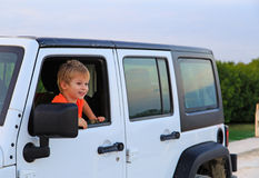 Little boy in off-road car, family vacation Royalty Free Stock Photo