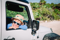Little boy in off road car, family vacation Royalty Free Stock Photography