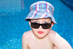 Little boy oiled up with sun cream. On holiday Stock Photos