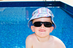 Little boy oiled up with sun cream. On holiday Stock Image