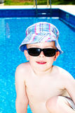 Little boy oiled up with sun cream. On holiday Royalty Free Stock Image