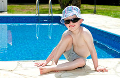 Little boy oiled up with sun cream. On holiday Stock Photography