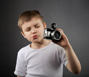 Little boy with old camera Stock Photos