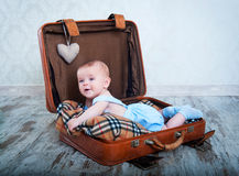 little boy in the old days a suitcase Stock Photography