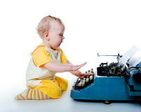 Little boy with the old typewriter Stock Images