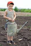 Little boy with old watering can Royalty Free Stock Photos