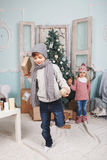Little boy on one leg and new year. Little boy on one leg and his sister and new year stock photography