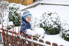 Little boy of one year having fun with snow Stock Photography