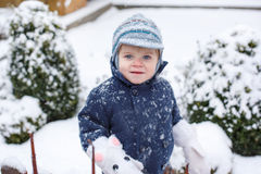 Little boy of one year having fun with snow Royalty Free Stock Photos