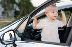 Little boy in an open car door Stock Photography